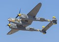 P-38 Lightning pass at an airshow in California.