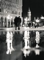 Water coming from below, streets mostly deserted, Venice at night