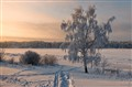 Sunrise over snow covered river